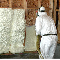 Contractor installng spray foam insulation